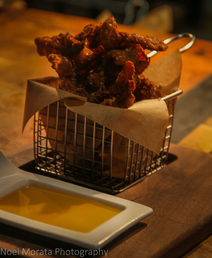Crispy chicken skins and smoked honey dip