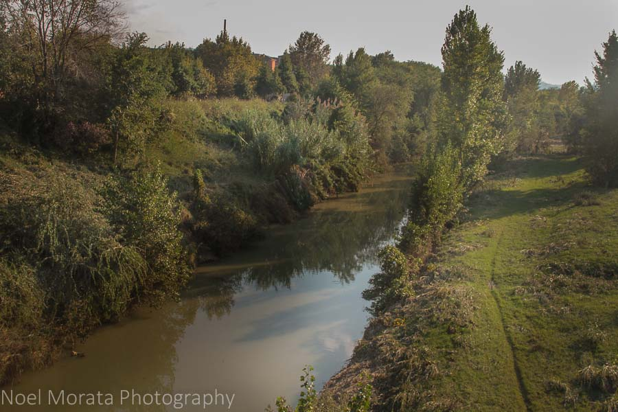 A scenic river lies just out of the medieval walls of Faenza