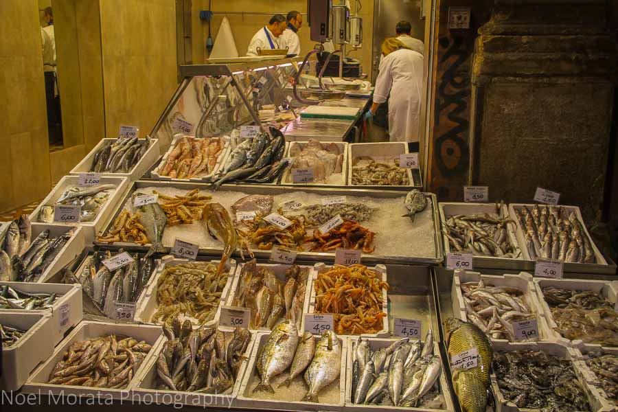 Shopping for fish after hours in the ancient market of Bologna