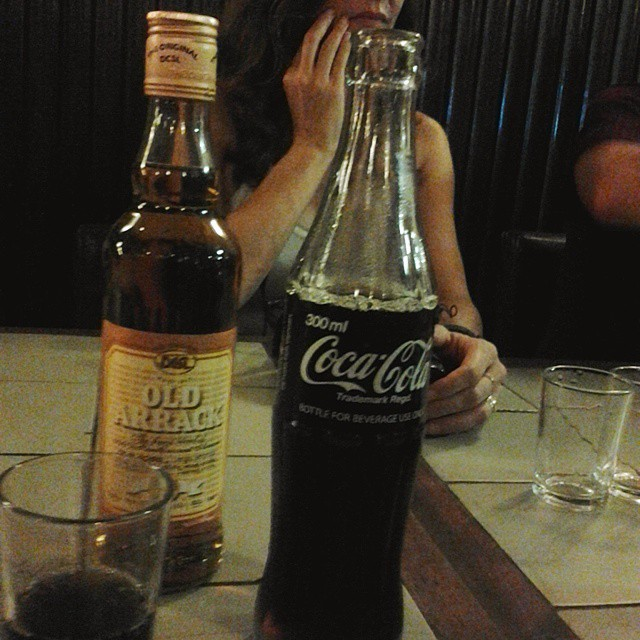 Traditional serving of Old Arrack and Coca Cola