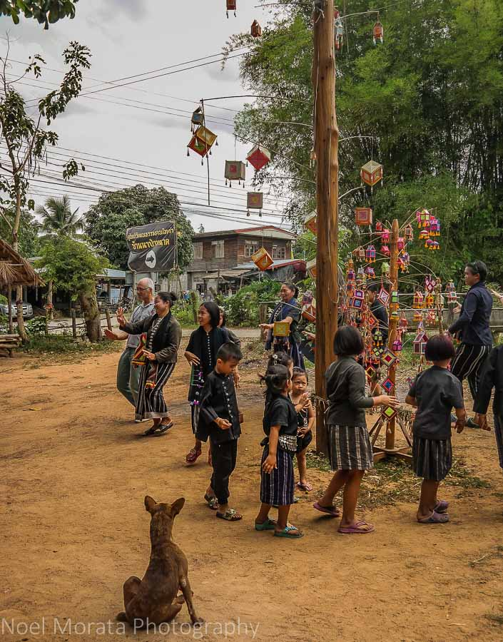 Dance around a maypole at the Ta Dam cultural village