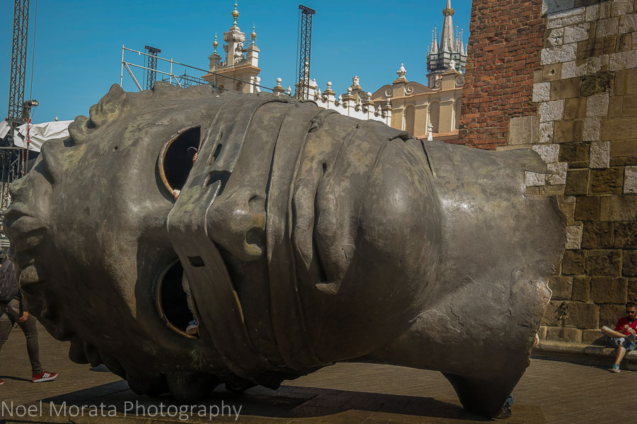 Krakow highlights in one day - modern head sculpture on the main square of Krakow