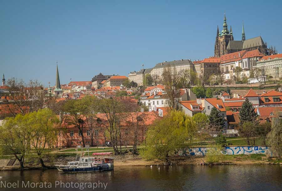 Views of Prague's New Town, castle and cathedral across the Vltava River