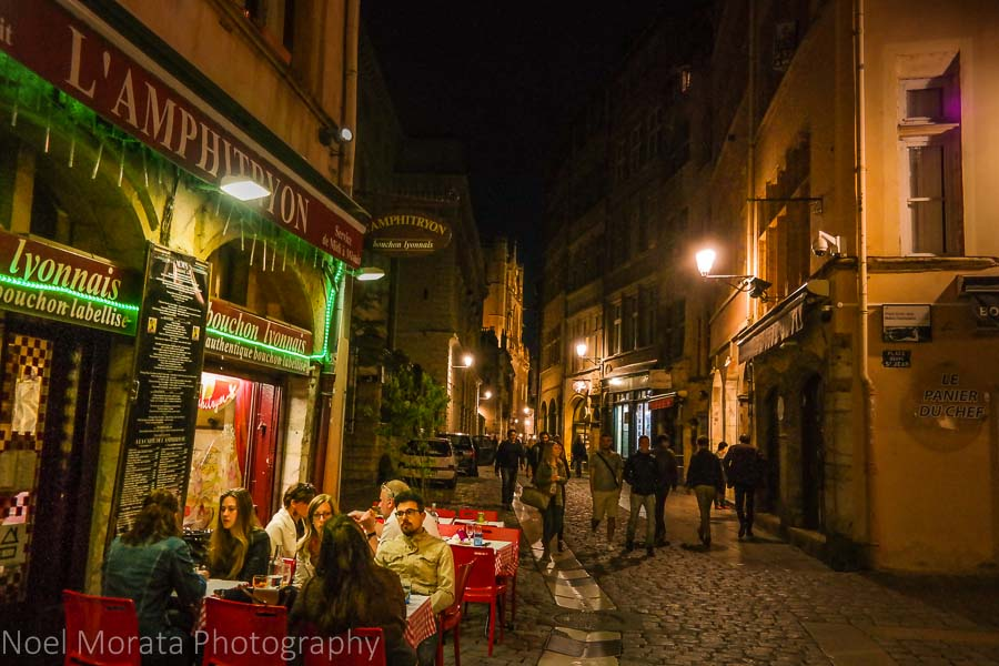 A busy promenade at night in Lyon, France