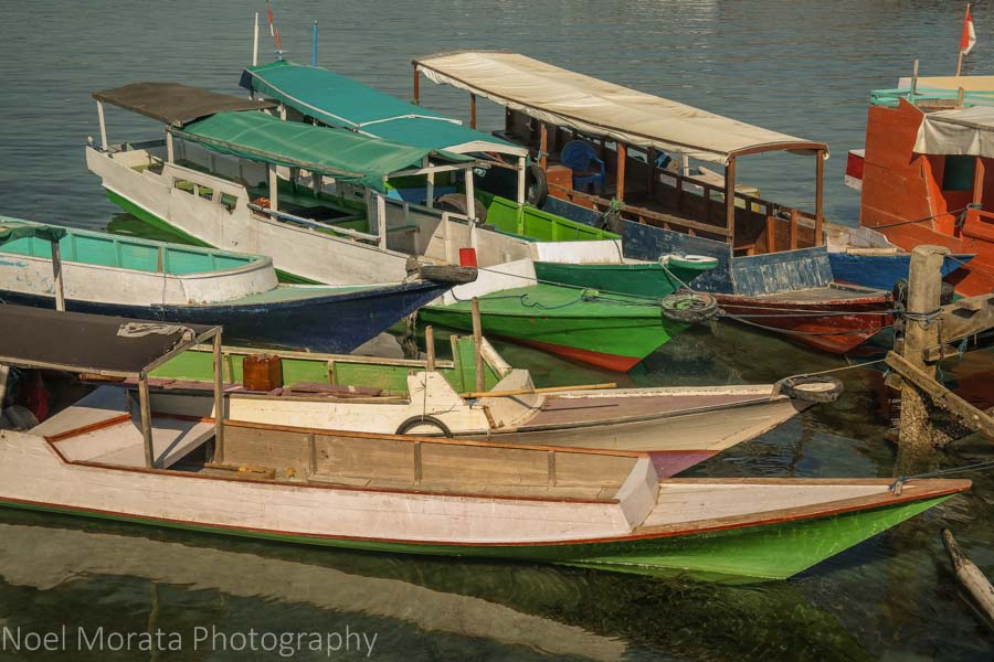 Colorful boats at the scenic port town of Labuan Bajo - Visiting Komodo National Park