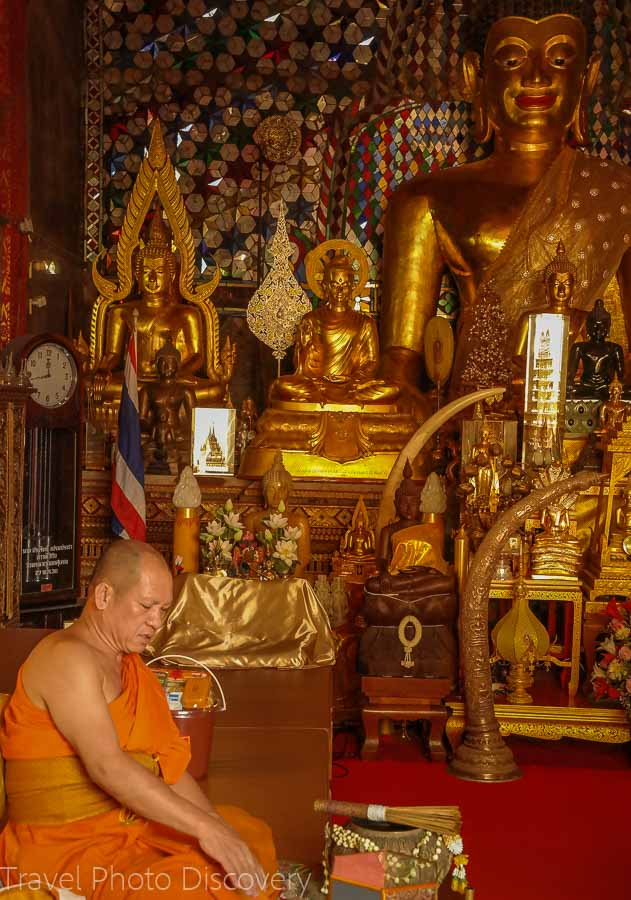 Monk in a shrine Visiting Wat Phra That Doi Suthep