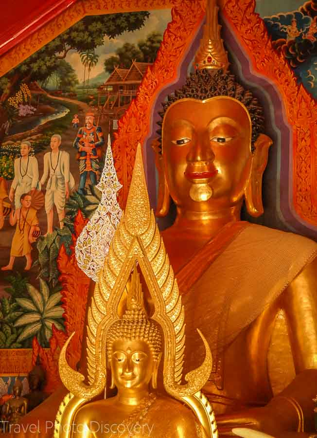 Buddhas and murals at the inner temple compound of Doi Suthep