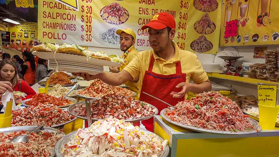 Touring Mexico City Tours by Locals visiting a local market and ceviche stalls