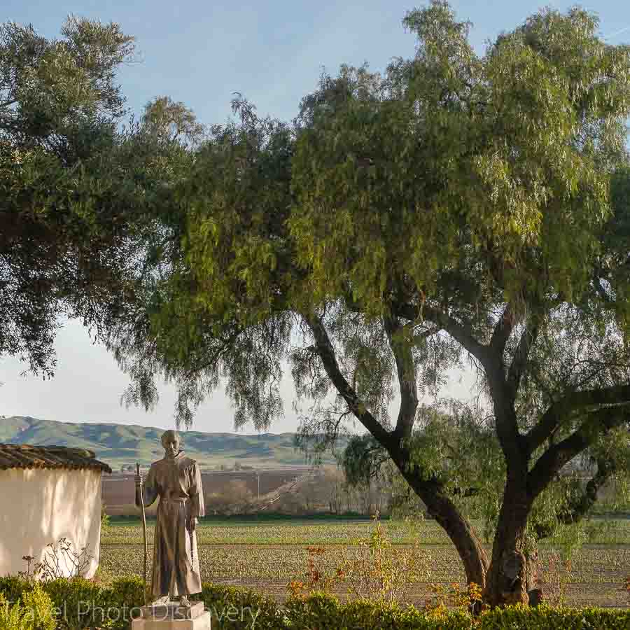 Father Serra and vineyards at Mission San Juan Bautista