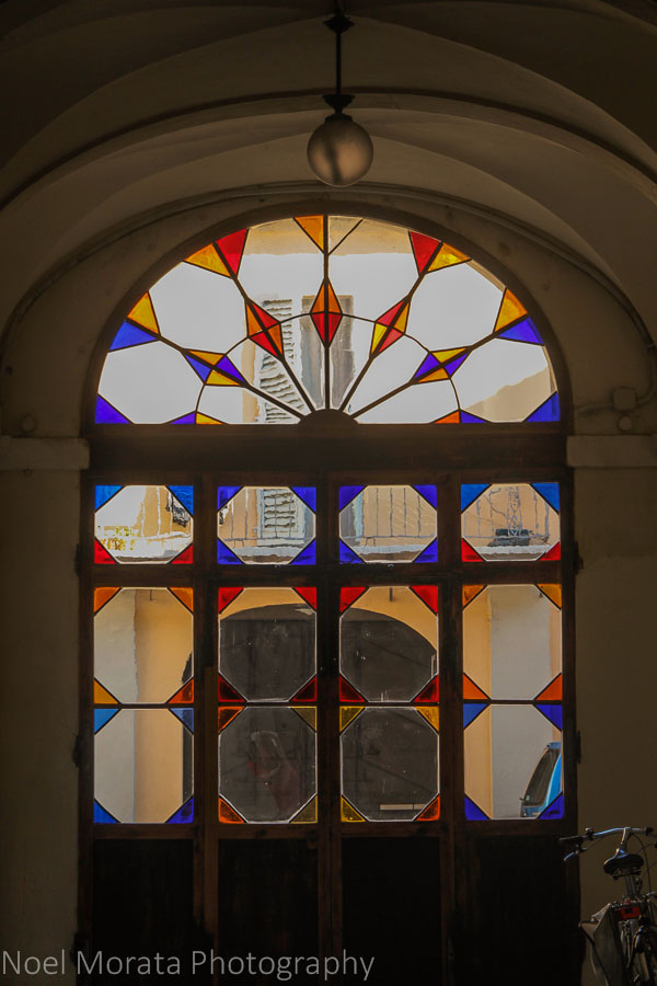 Elegant facades and stain glass features in Faenza