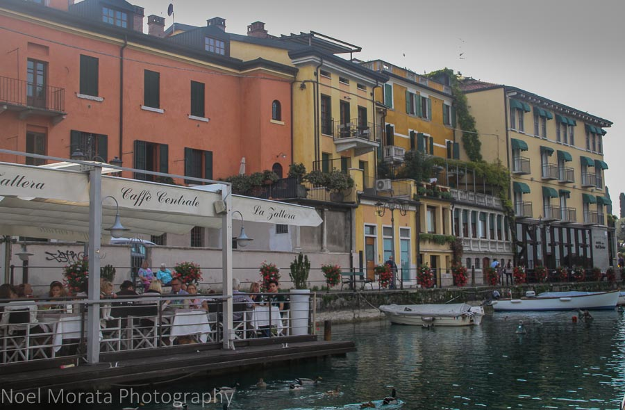 Leaving the dock and river front at Lake Garda in Peschiera
