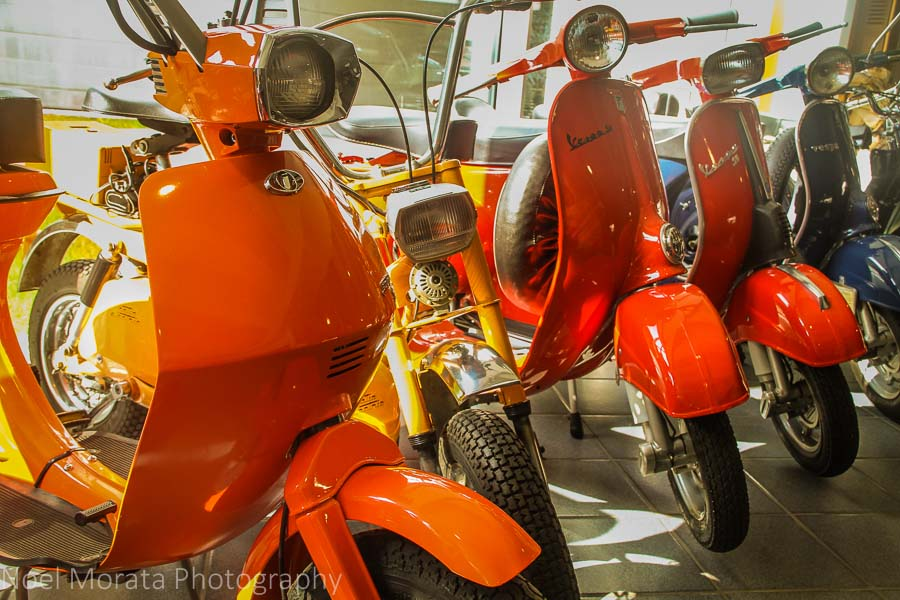 Colorful mopeds at the entrance of the Museo Nicolis at  VeronaVerona