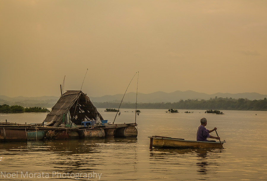 Rowing back to a floating home at Chiang Khan