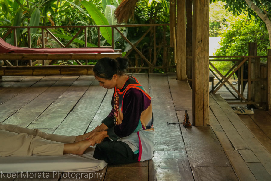 Thai massage on the covered living space at Lisu Lodge