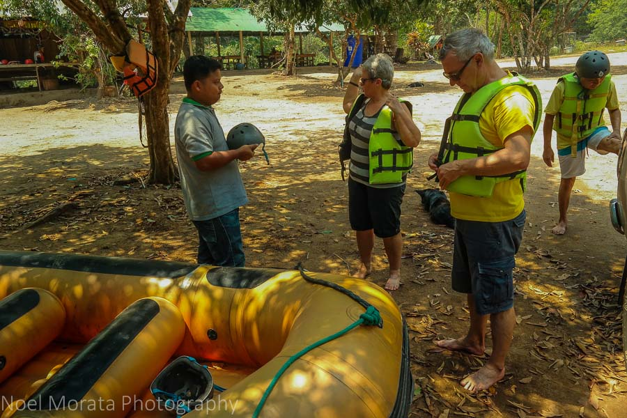 Putting on life vests at Mae Taeng river