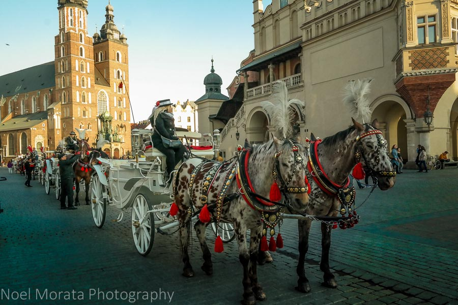 Krakow highlights in one day - Krakow Cloth Hall on the main square - Krakow, Poland - a first impression, horse drawn carriages on the main square