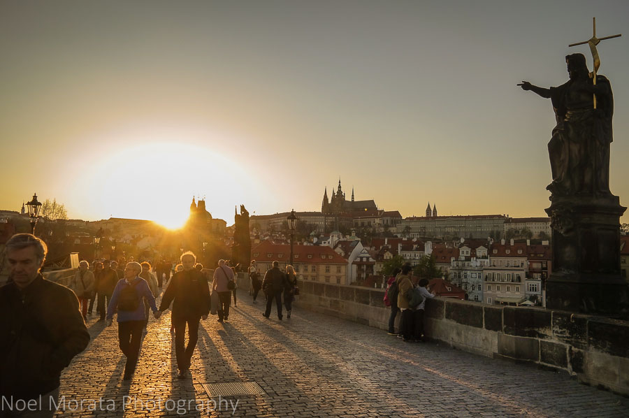 15 stunning views of Prague - on the St. Charles bridge at dusk