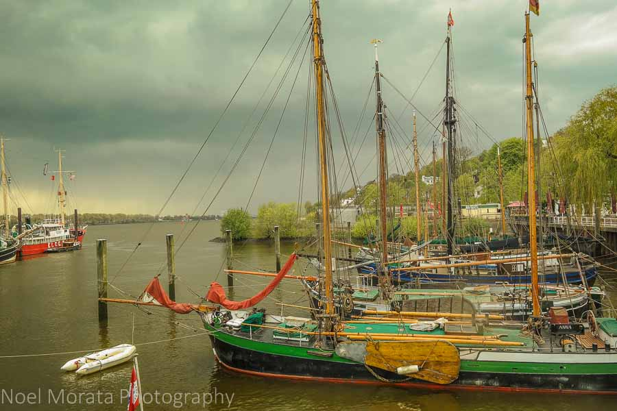 Traditional sailing vessels in a waterfront community along Hamburg harbor