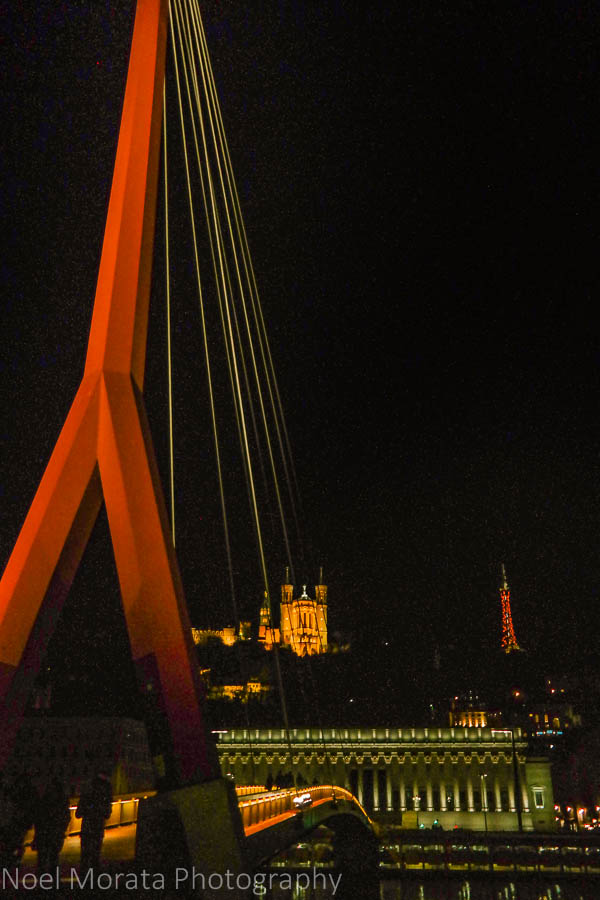Pedestrian bridge along the Saone river, Lyon, France at night time