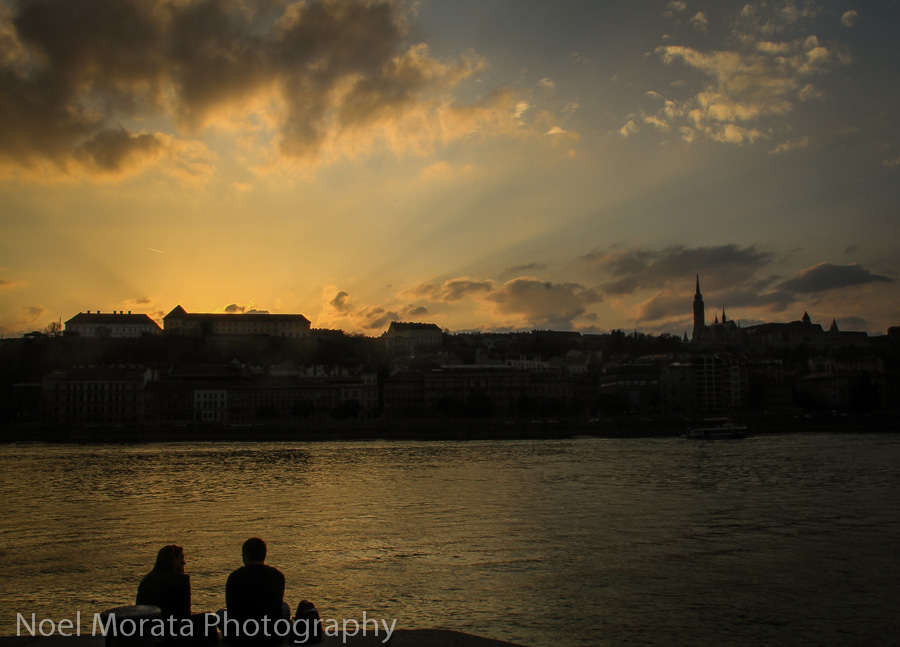 Sunset by the Danube river promenade touring Budapest at night