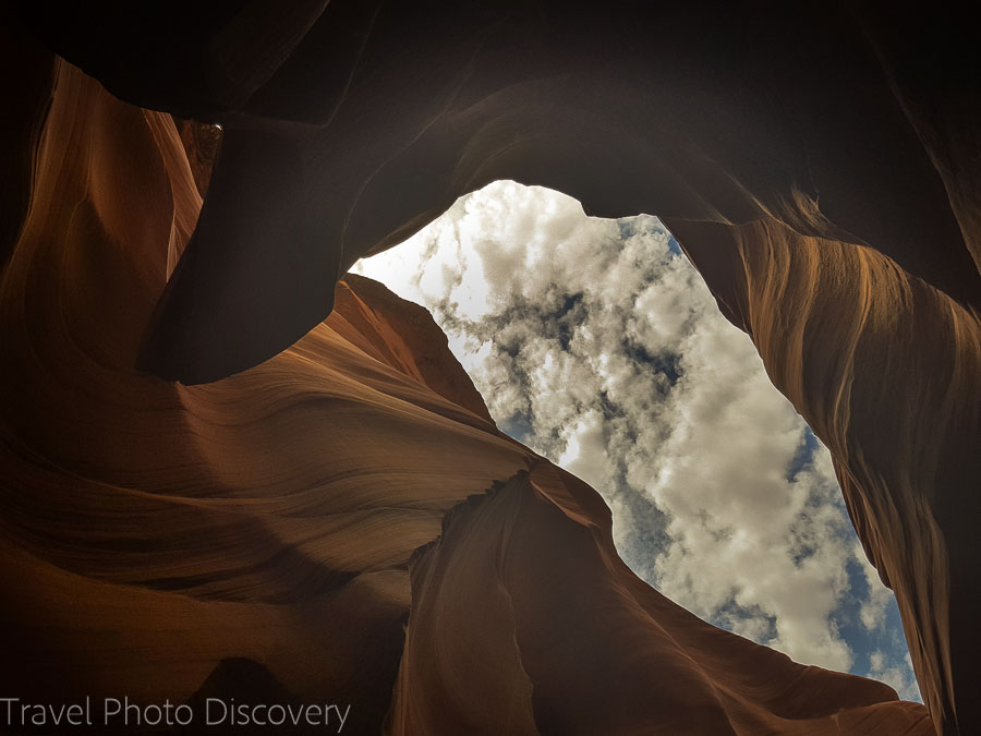 Clouds and blue skies looking up in lower Antelope Canyon