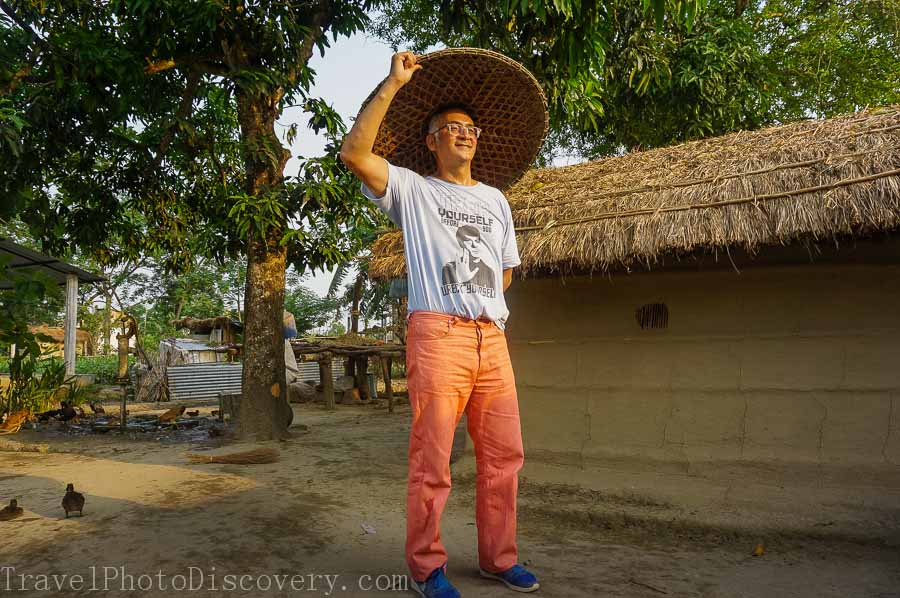 Trying a hat at a local village outside Chitwan National Park