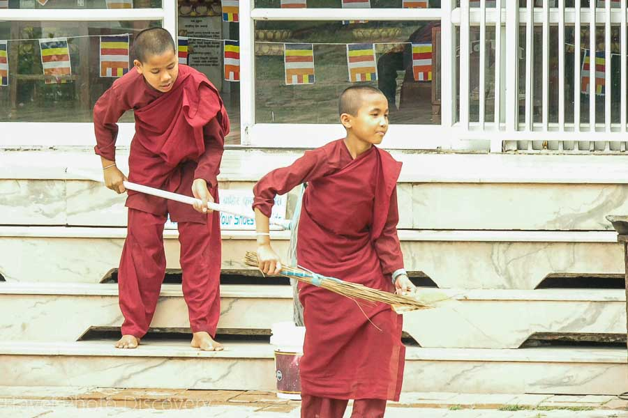 Daily chores with young monks cleaning the grounds of a monastery in Lumbini