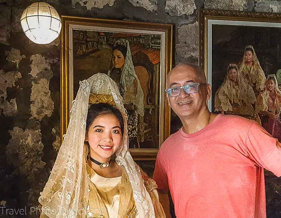 Posing with a young Filipina in costume in Cebu