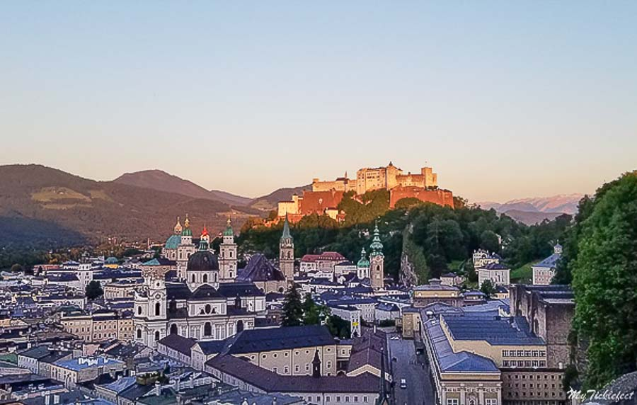 View of Fortress Salzburg at sunset things to do in Salzburg Austria