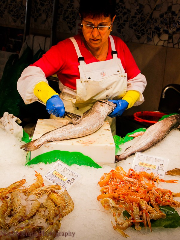 fishmonger at a public market in Barcelona