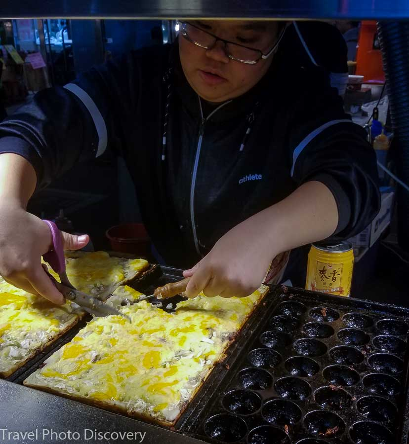 Local eggy dishes with custom toppings at a night market in Taipei
