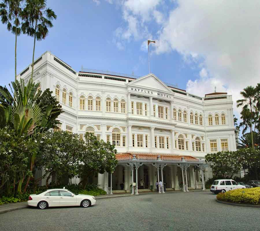 Take a photo of the Raffles hotel and visit the museum inside